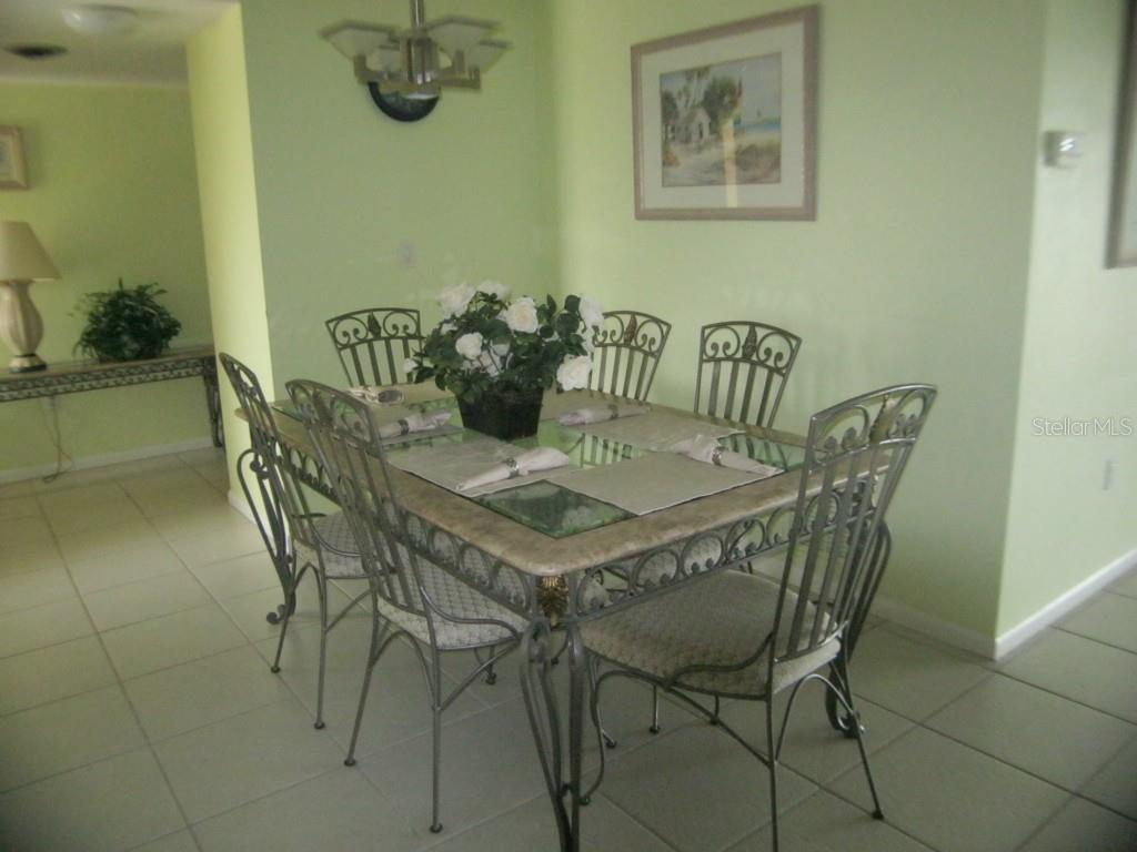 This area is currently set up as the dining area, though there are other options for the use of this space. - Single Family Home for sale at 450 Coral Creek Dr, Placida, FL 33946 - MLS Number is D5901346