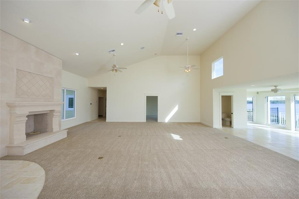 Great Room with Volume Ceiling - Single Family Home for sale at 7295 Manasota Key Rd, Englewood, FL 34223 - MLS Number is D5911936