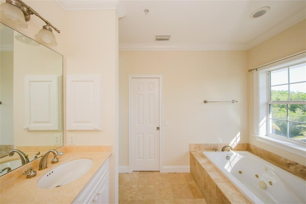 Downstairs Second Master Bathroom - Single Family Home for sale at 7020 Palm Island Dr, Placida, FL 33946 - MLS Number is D5917629