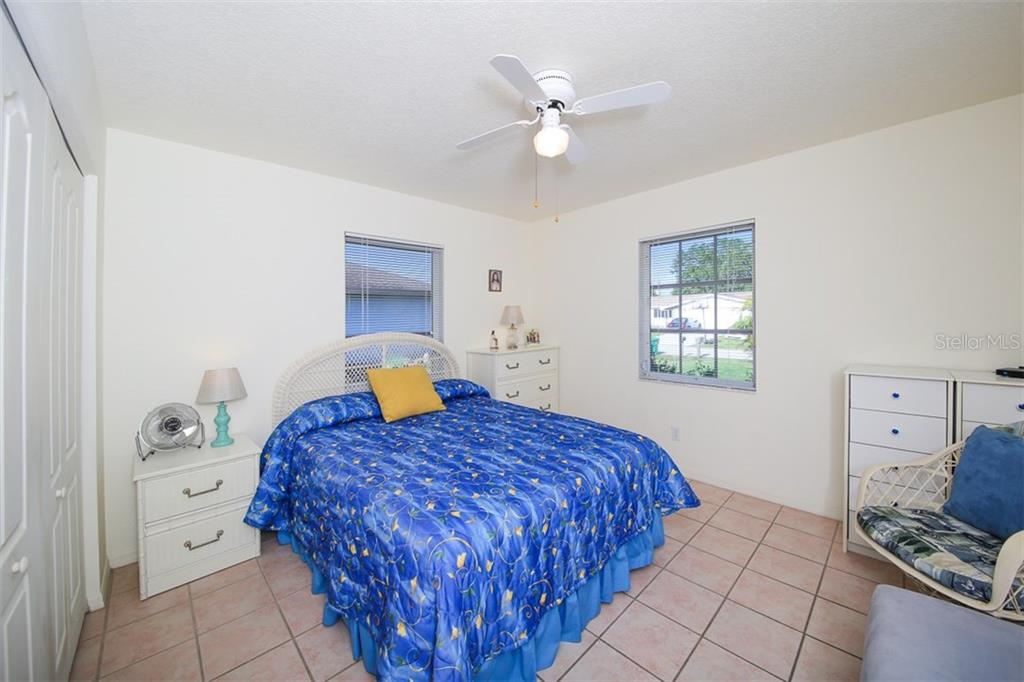 Bedroom #2 - Single Family Home for sale at 7044 Quigley St, Englewood, FL 34224 - MLS Number is D5918526