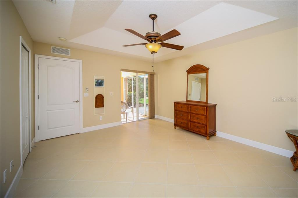 Master bedroom with access to the lanai - Single Family Home for sale at 414 Tomoka Dr, Englewood, FL 34223 - MLS Number is D5919831