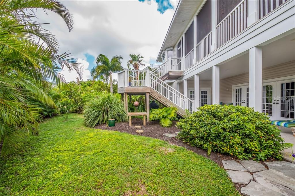 Landscaped back yard - Single Family Home for sale at 9891 Gasparilla Pass Blvd, Boca Grande, FL 33921 - MLS Number is D5920572