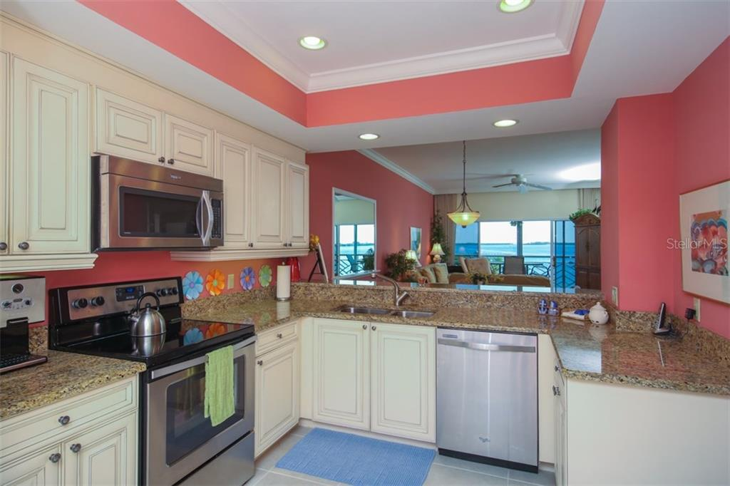 Kitchen - Condo for sale at 11000 Placida Rd #309, Placida, FL 33946 - MLS Number is D5921681