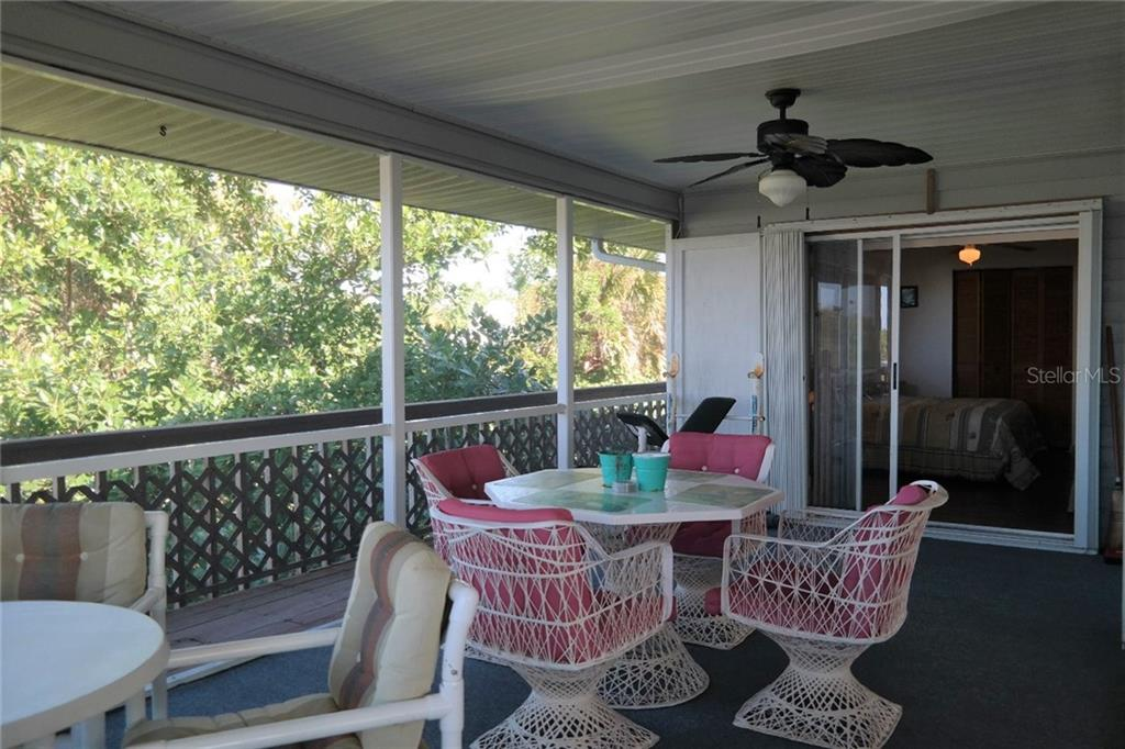 Screened in lanai off the dining room and master bedroom. - Single Family Home for sale at 8384 Little Gasparilla Is, Placida, FL 33946 - MLS Number is D5922085