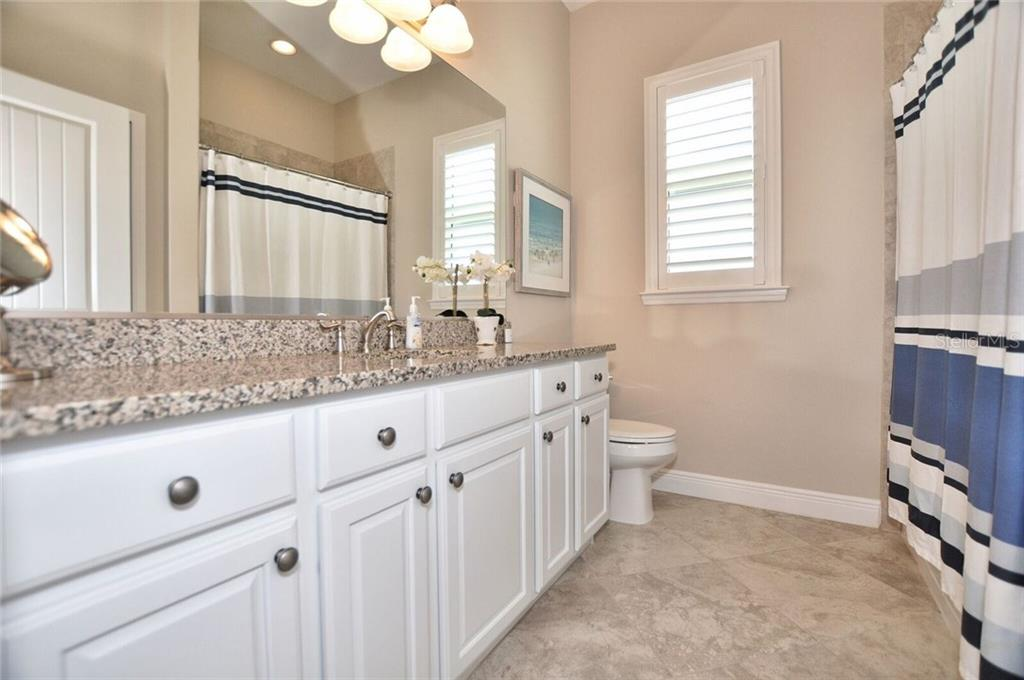Guest bathroom - Single Family Home for sale at 8944 Scallop Way, Placida, FL 33946 - MLS Number is D5923173
