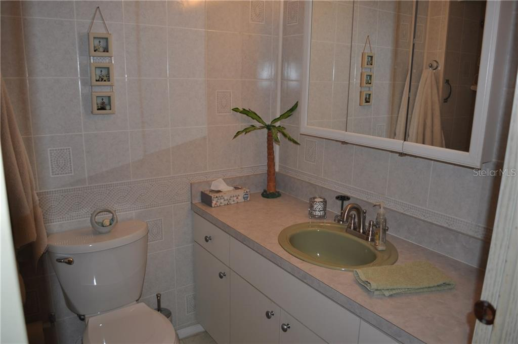 THIS IS THE GUEST BATHROOM.  TOILET IS NEW AND IT HAS A TUB/SHOWER COMBO. - Single Family Home for sale at 1586 Blue Heron Dr, Englewood, FL 34224 - MLS Number is D5923669