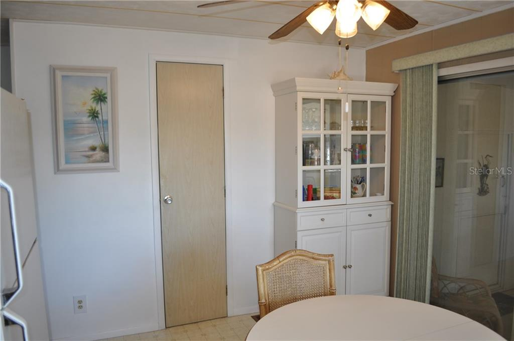 THE DOOR IS TO THE WALK IN PANTRY. - Single Family Home for sale at 1586 Blue Heron Dr, Englewood, FL 34224 - MLS Number is D5923669