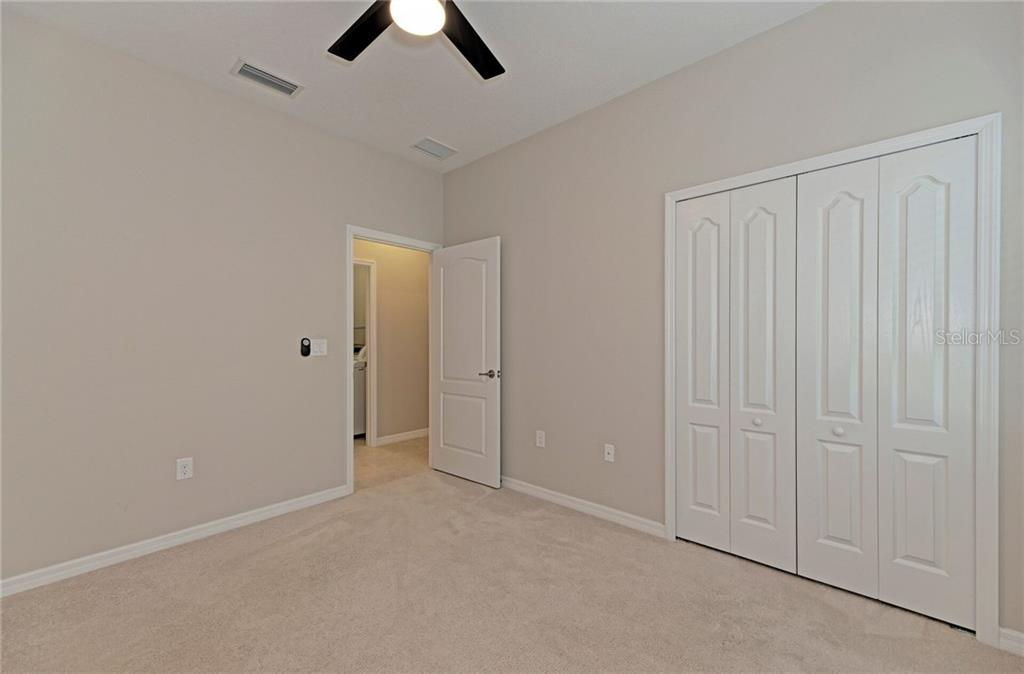 One of the guest bedrooms with large closet. - Single Family Home for sale at 141 Avens Dr, Nokomis, FL 34275 - MLS Number is D6100104