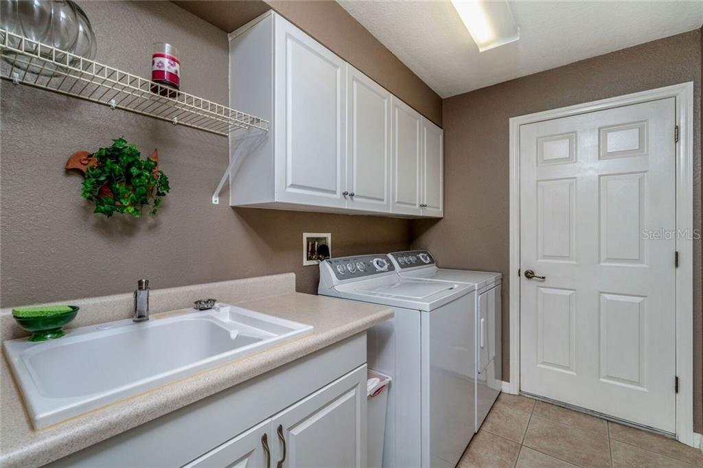 Indoor Laundry room with entrance to garage - Single Family Home for sale at 11205 Gulfstream Blvd, Port Charlotte, FL 33981 - MLS Number is D6100390