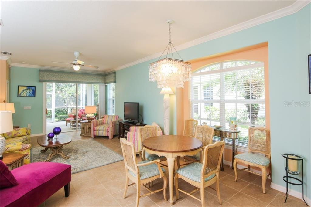 This large window is dressed up with faux blinds, as is the theme throughout this villa. - Villa for sale at 29704 Niagara Ct, Englewood, FL 34223 - MLS Number is D6102386