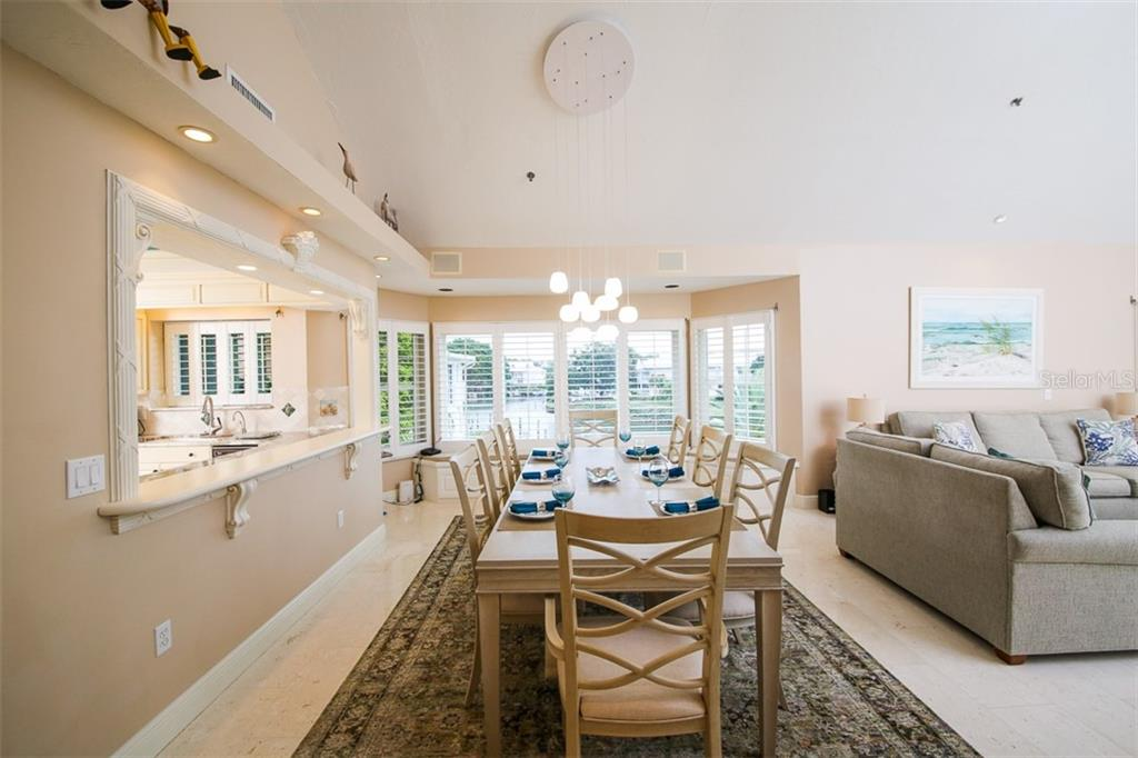 Dining Room with plantation shutters - Condo for sale at 11000 Placida Rd #2103, Placida, FL 33946 - MLS Number is D6102674