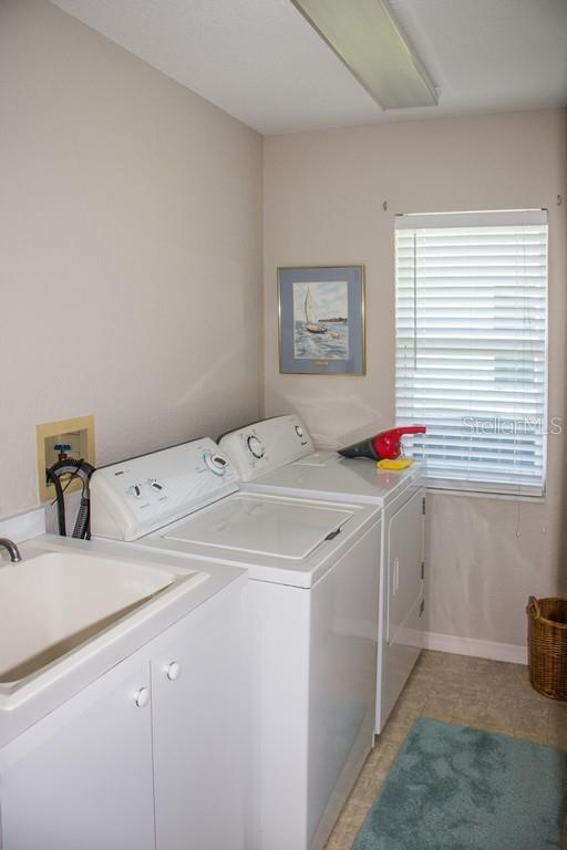 Large laundry room. - Single Family Home for sale at 14 Long Meadow Ln, Rotonda West, FL 33947 - MLS Number is D6102683