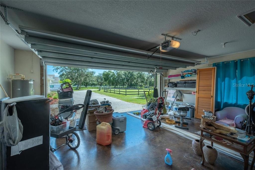 2 car garage with automatic opener has a hurricane rated door, attic storage, vent for an A/C unit - Single Family Home for sale at 7339 Hawkins Rd, Sarasota, FL 34241 - MLS Number is D6102762