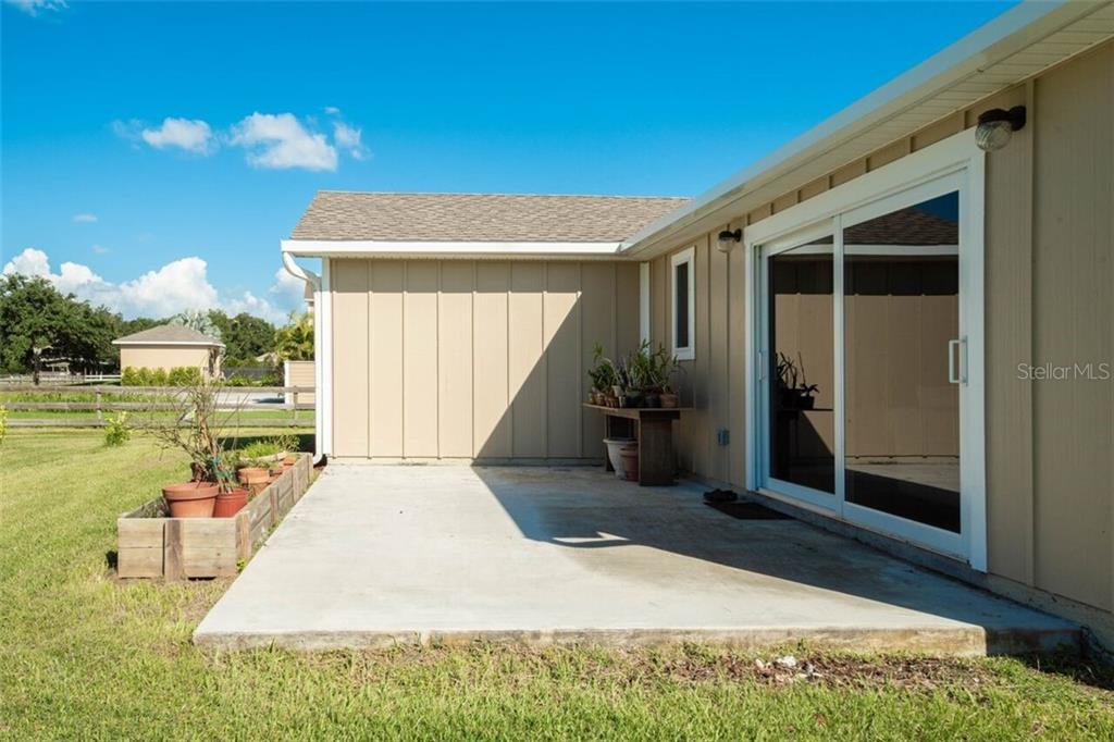 The dwelling unit has a little raised garden next to the patio.  The structural gutter on the back is suitable to hold a porch roof.  Impact windows and doors here too! Features it's own electric meter and septic tank! - Single Family Home for sale at 7339 Hawkins Rd, Sarasota, FL 34241 - MLS Number is D6102762