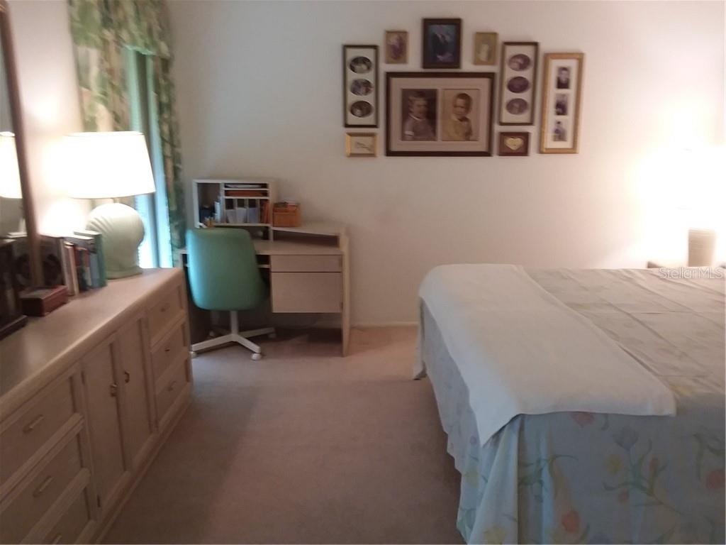 Master Bedroom/Desk Area - Single Family Home for sale at 7 Old Trail Rd, Englewood, FL 34223 - MLS Number is D6102912
