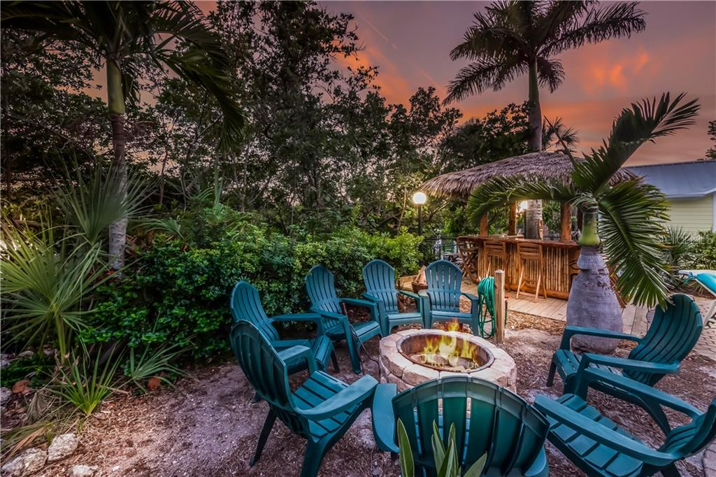 Pool (party) area and one dock on one lot - Single Family Home for sale at 101 N Gulf Blvd, Placida, FL 33946 - MLS Number is D6103476