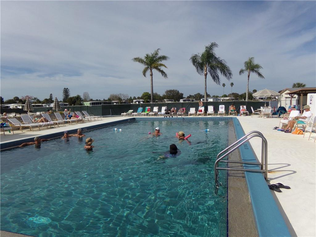 Fun at the pool - Manufactured Home for sale at 6294 Bunting Ln, Englewood, FL 34224 - MLS Number is D6103685
