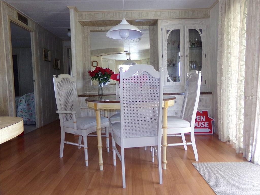 Dining Room with Built in Hutch - Manufactured Home for sale at 6294 Bunting Ln, Englewood, FL 34224 - MLS Number is D6103685