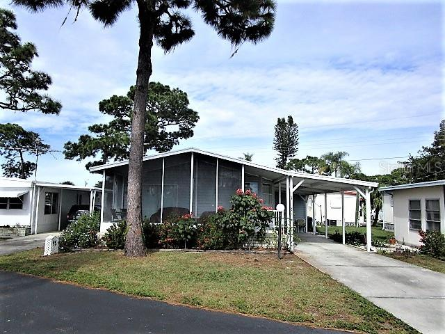 There's more to this home than meets the eye.! - Manufactured Home for sale at 1800 Englewood Rd #95, Englewood, FL 34223 - MLS Number is D6103776