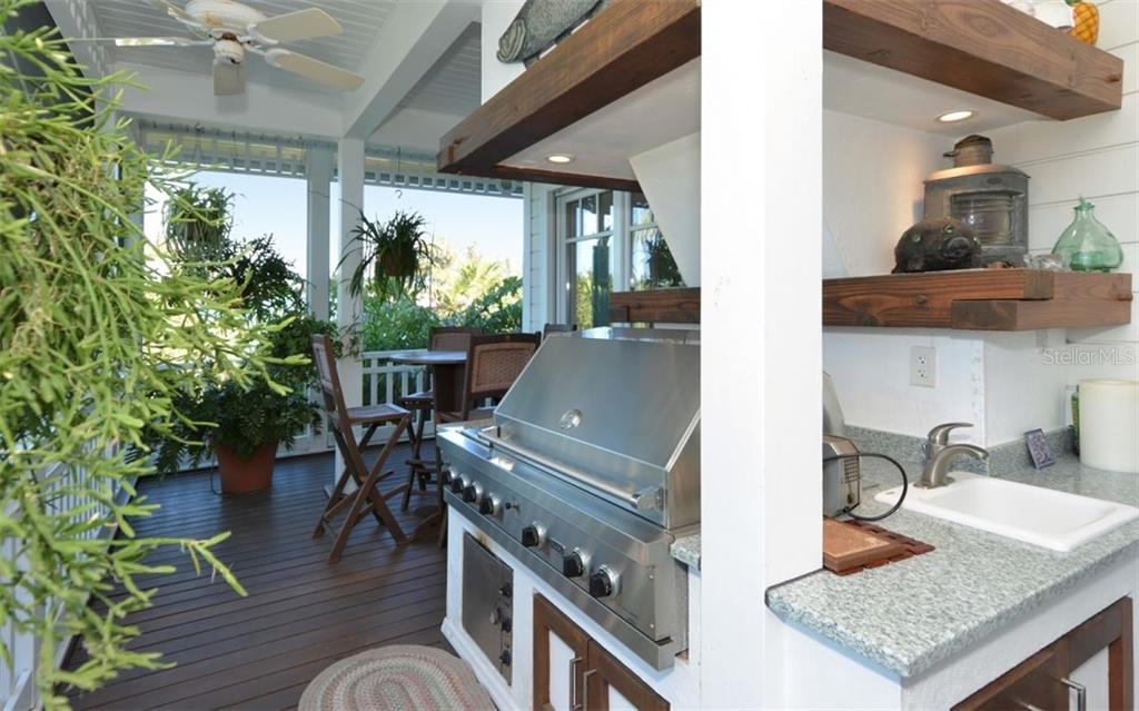 Lanai Kitchen - Single Family Home for sale at 161 Kettle Harbor Dr, Placida, FL 33946 - MLS Number is D6104075