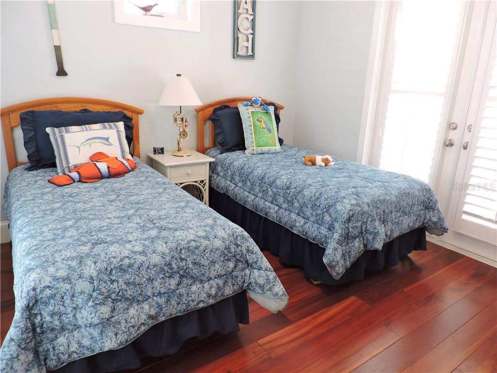 Guest Bedroom. - Single Family Home for sale at 111 Kettle Harbor Dr, Placida, FL 33946 - MLS Number is D6104218