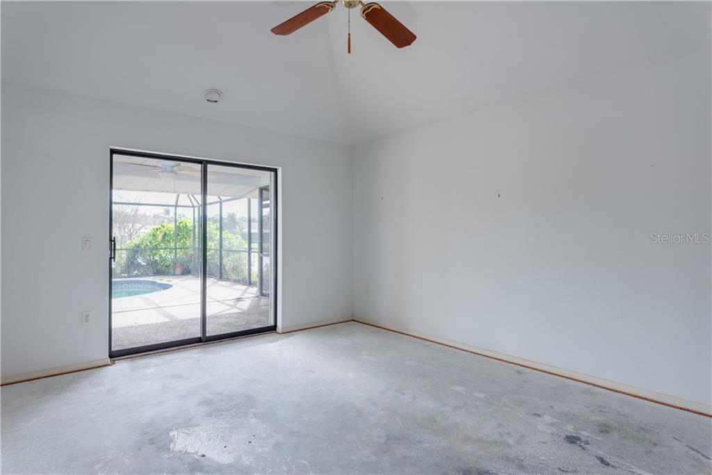 Master Bedroom - Single Family Home for sale at 487 Dover Cir, Englewood, FL 34223 - MLS Number is D6104435