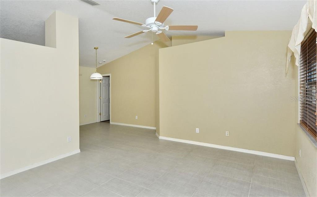 Living Room/Dining Room Combo with New Tile Flooring - Single Family Home for sale at 5376 Ashwood Rd, Port Charlotte, FL 33981 - MLS Number is D6105888