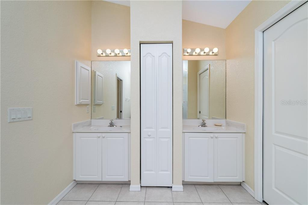 Master bath has his & her vanities and linen closet. - Single Family Home for sale at 30 Medalist Way, Rotonda West, FL 33947 - MLS Number is D6106239