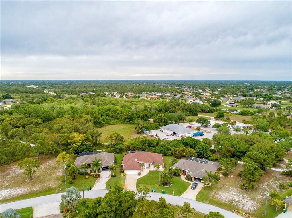 An aerial view of the property and surrounding area. - Single Family Home for sale at 30 Medalist Way, Rotonda West, FL 33947 - MLS Number is D6106239