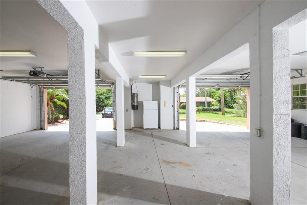 AMAZING garage space!  Doors are 8' high. - Single Family Home for sale at 9033 Allapata Ln, Venice, FL 34293 - MLS Number is D6106356