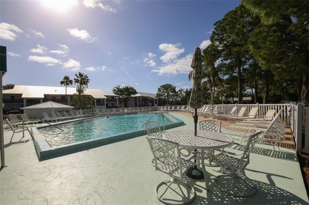 Community pool with lots of room for sun lovers and socializing with friends. - Condo for sale at 6800 Placida Rd #271, Englewood, FL 34224 - MLS Number is D6106459