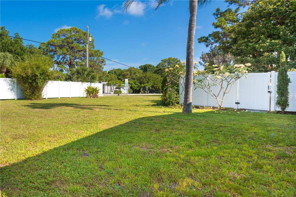 Most of the yard is fenced for the privacy of you and your guests - Single Family Home for sale at 190 W Wentworth St, Englewood, FL 34223 - MLS Number is D6106918