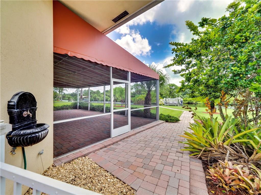 Walkway to back screened lanai and waterway - Single Family Home for sale at 13283 Eisenhower Dr, Port Charlotte, FL 33953 - MLS Number is D6107998