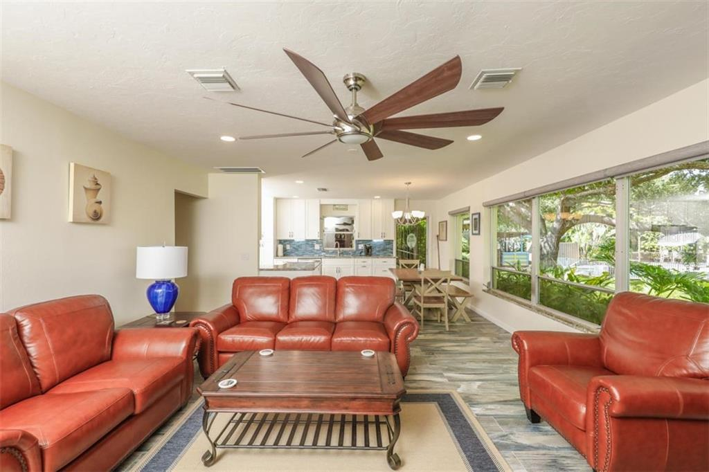 Family Room - Single Family Home for sale at 140 S Oxford Dr, Englewood, FL 34223 - MLS Number is D6108024