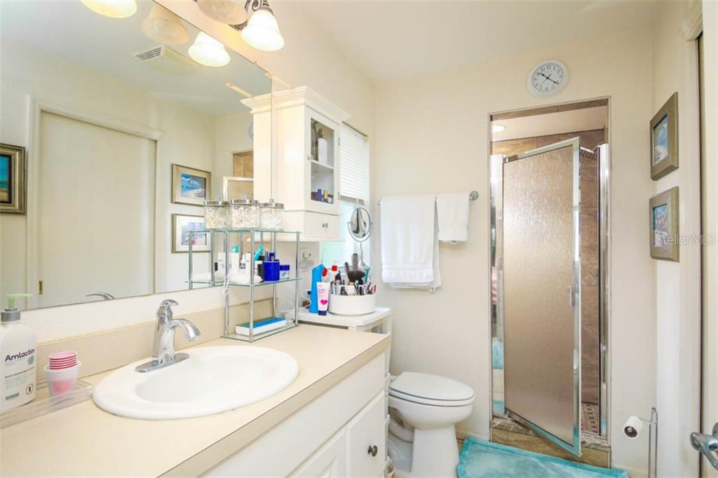 remodeled master bath with new tile shower - Single Family Home for sale at 913 Tropical Ave Nw, Port Charlotte, FL 33948 - MLS Number is D6108061