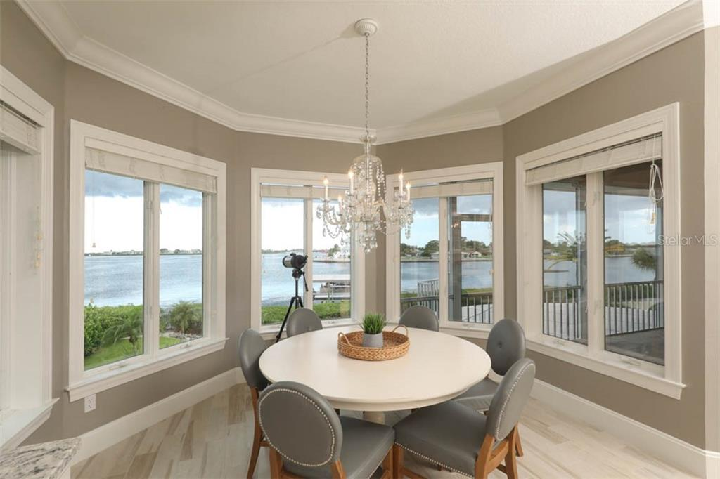 Dining Room with Panoramic Views - Single Family Home for sale at 1636 New Point Comfort Rd, Englewood, FL 34223 - MLS Number is D6108467