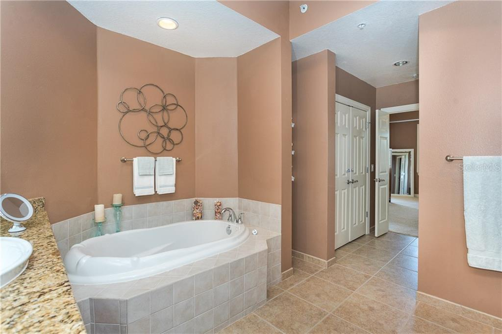 Master Bath Suite with Large Soaking Tub for those times you want to unwind - Condo for sale at 8561 Amberjack Cir #202, Englewood, FL 34224 - MLS Number is D6109771