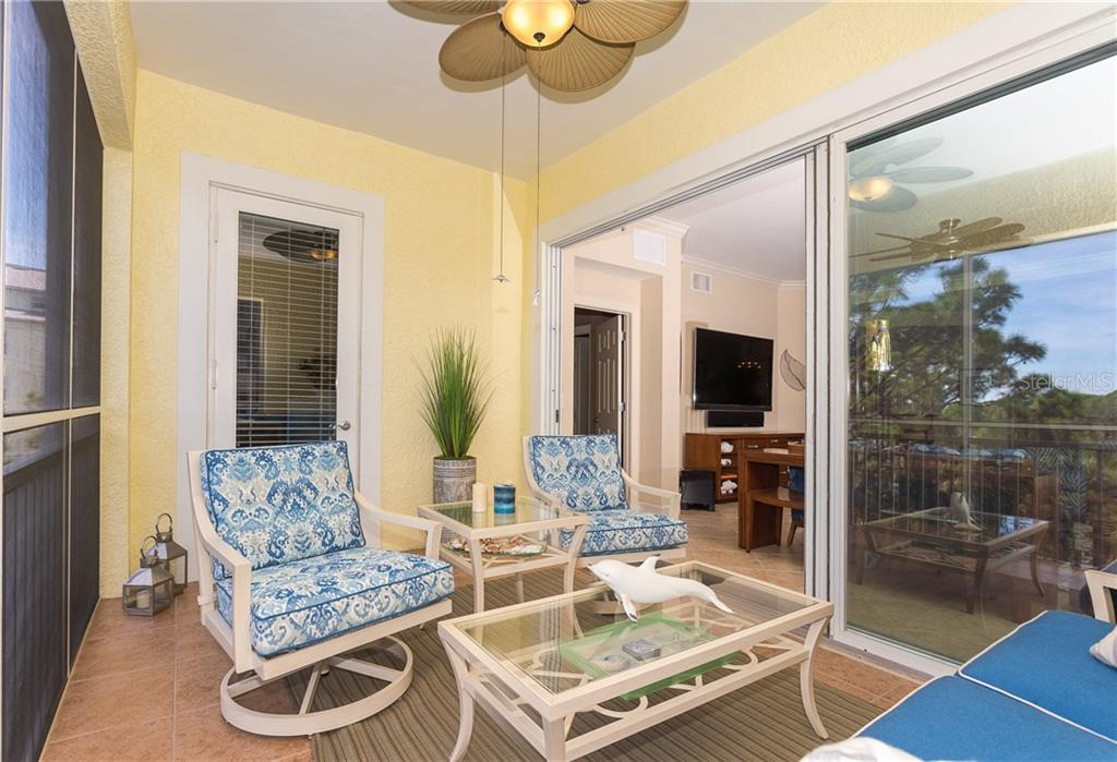 Spacious Lanai that lets the outdoors in - Condo for sale at 8561 Amberjack Cir #202, Englewood, FL 34224 - MLS Number is D6109771