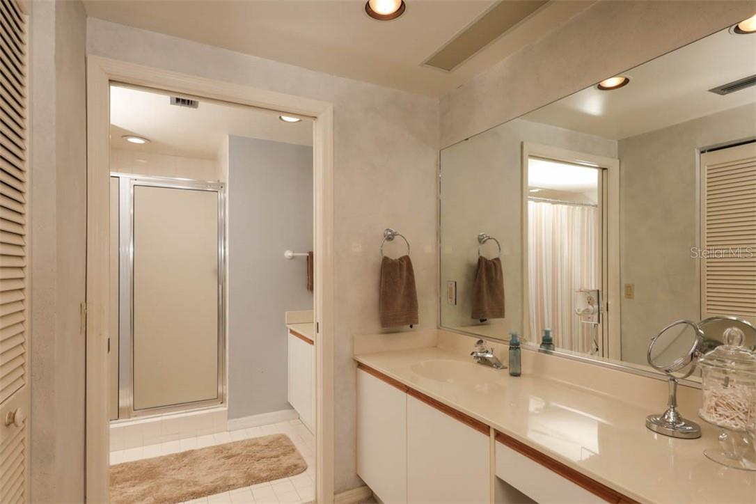 Master Bath features 2 separate vanities - Condo for sale at 11000 Placida Rd #306, Placida, FL 33946 - MLS Number is D6110298