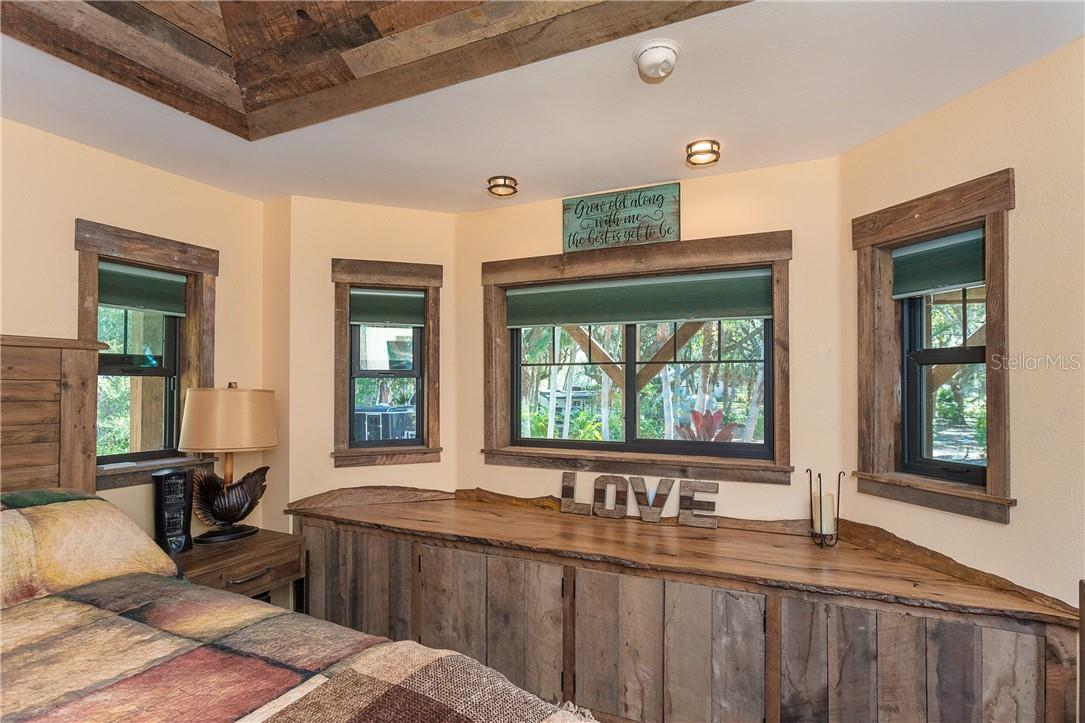 Built in barnwood cabinet with custom oak top repurposed from oak tree originally on site - Single Family Home for sale at 1199 Seahorse Ln, Englewood, FL 34224 - MLS Number is D6110877