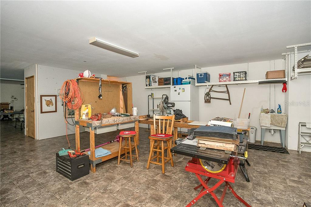Ground level offers plenty of room for whatever hobby you are into or just storage space. - Single Family Home for sale at 550 S Oxford Dr, Englewood, FL 34223 - MLS Number is D6111512