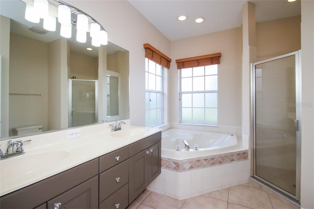 MASTER BATH WITH DUAL SINKS, GARDEN TUB AND WALK-IN SHOWER - Single Family Home for sale at 3583 Royal Palm Dr, North Port, FL 34288 - MLS Number is D6111716
