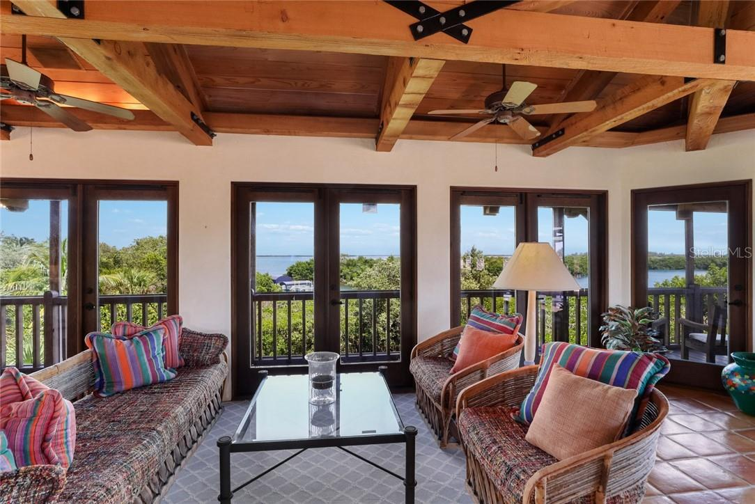 Breathtaking views from one of three sitting areas in the living room - Single Family Home for sale at 4090 Loomis Ave, Boca Grande, FL 33921 - MLS Number is D6112331