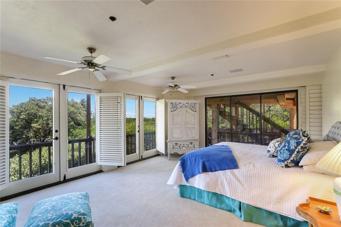 Large Master with views, plantation shutters and direct access to balcony and upper floor - Single Family Home for sale at 4090 Loomis Ave, Boca Grande, FL 33921 - MLS Number is D6112331