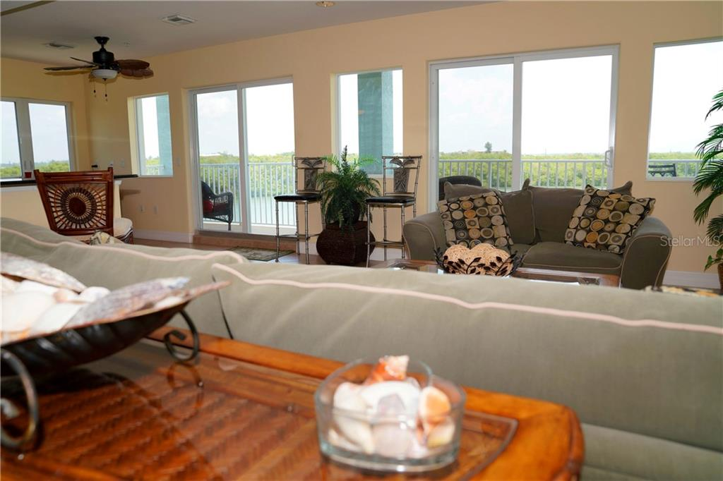 Lots of windows strategically placed for great water views and lots of light! - Condo for sale at 2245 N Beach Rd #304, Englewood, FL 34223 - MLS Number is D6112346