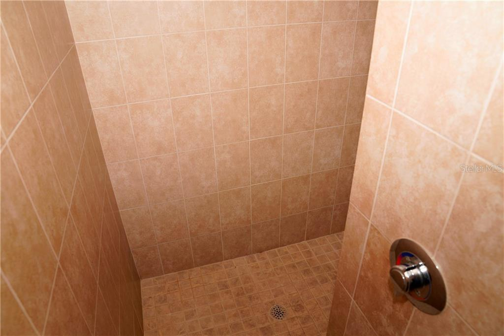 Walk-in shower with faucet on front to adjust before entering. - Condo for sale at 2245 N Beach Rd #304, Englewood, FL 34223 - MLS Number is D6112346
