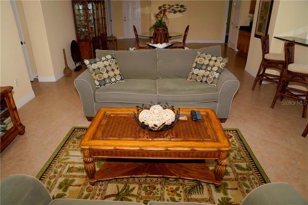 View from living room into dining room - open floor plan - Condo for sale at 2245 N Beach Rd #304, Englewood, FL 34223 - MLS Number is D6112346
