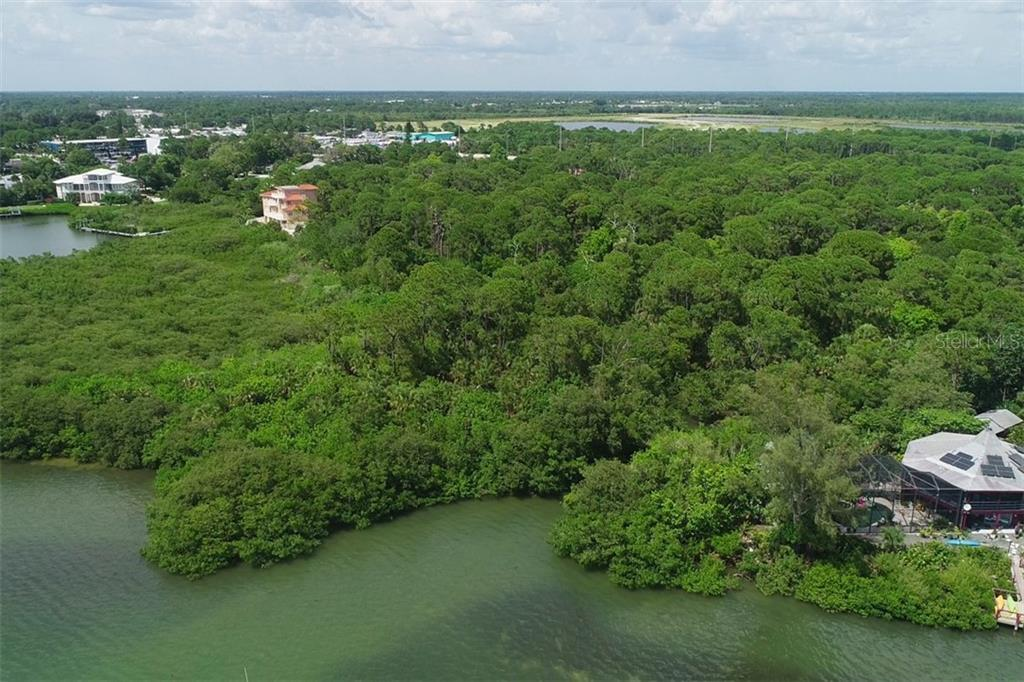 Property lies between 2 homes - Vacant Land for sale at 9427 Downing St, Englewood, FL 34224 - MLS Number is D6112667
