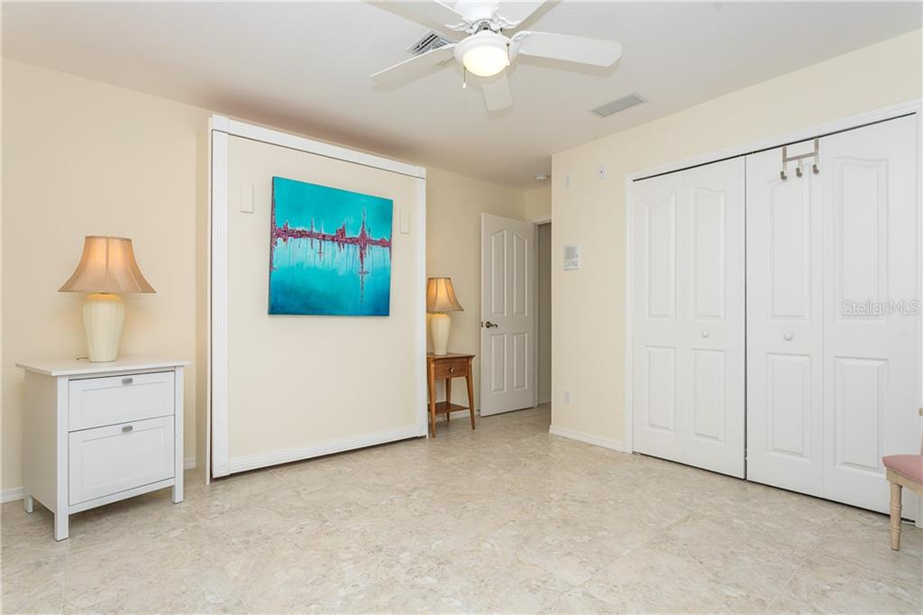 Bedroom 3 - Murphy Bed to allow to use as office/Den if needed - Single Family Home for sale at 15276 Leipzig Cir, Port Charlotte, FL 33981 - MLS Number is D6113034