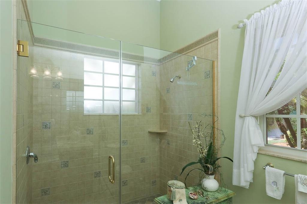 Shower in Second Bath - Single Family Home for sale at 9300 Hialeah Ter, Port Charlotte, FL 33981 - MLS Number is D6113597